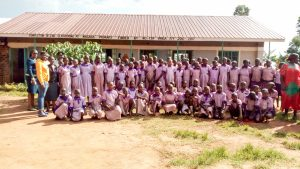 The Water Project:  Students And Staff Posing In Front Of Classrooms