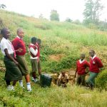 The Water Project: Kaimosi Demonstration Secondary School -  Fetching Water