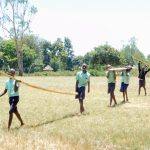 The Water Project: Mukunyuku RC Primary School -  Students Helping Bring Materials To The Site