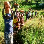 The Water Project: Bukhanga Community -  People Delivering Bricks To The Artisan