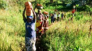 The Water Project:  People Delivering Bricks To The Artisan