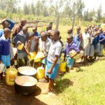 The Water Project: Lumakanda Township Primary School -  Pouring Water For Storage