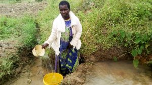 The Water Project:  Eldah Getting Water