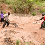 The Water Project: Syatu Community -  Sand Dam Construction