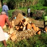 The Water Project: Bukhanga Community, Indangasi Spring -  People Delivering Bricks To The Artisan