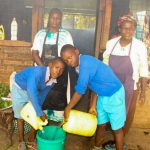 The Water Project: Lumakanda Township Primary School -  Delivering Water To The Kitchen