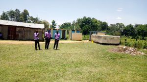 The Water Project:  Students In Front Of Latrines
