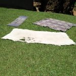 The Water Project: Mukoko Community, Mukoko Spring -  Blankets Drying Outside On The Ground