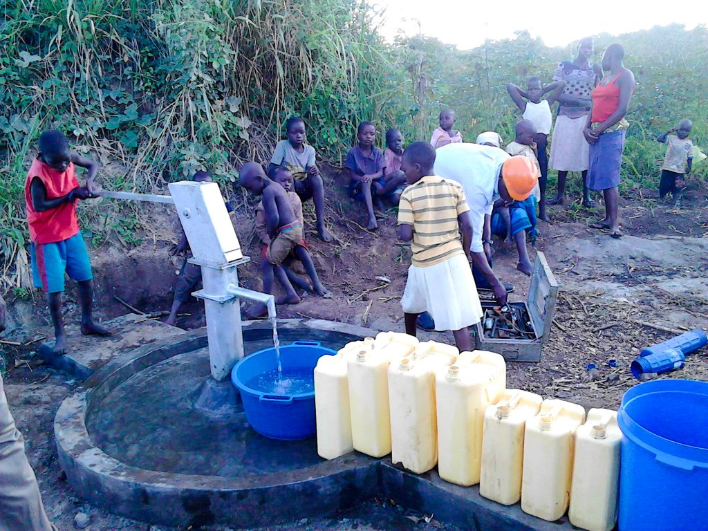 The Water Project : 16-uganda18303-flowing-water