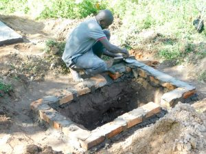 The Water Project:  Preparing The Pit For New Latrine