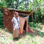 The Water Project: Rosterman Community, Kidiga Spring -  A Mud Latrine With A Wooden Floor