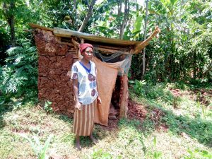 The Water Project:  A Mud Latrine With A Wooden Floor