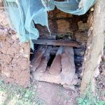 The Water Project: Rosterman Community, Kidiga Spring -  Dangerous Wooden Floor Over The Pit