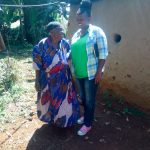 The Water Project: Shitsuvio Community, Shihevi Spring -  An Elderly Woman And Jakclyne Chelagat