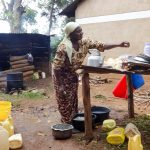The Water Project: Irobo Primary School -  School Cook And Water Containers