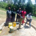 The Water Project: Namanja Secondary School -  School Staff Getting Water From The Community Well