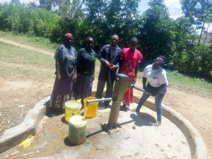 The Water Project:  School Staff Getting Water From The Community Well