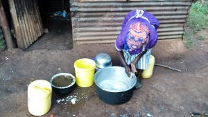 The Water Project:  School Cook Washing Containers