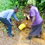 The Water Project: Ilala Community, Arnold Johnny Spring -  Fetching Water