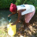 The Water Project: Mukoko Community, Mukoko Spring -  Peninah Fetching Water