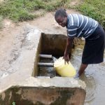 The Water Project: Irobo Primary School -  Cook Drawing Water