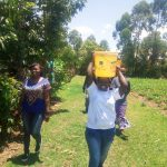 The Water Project: Namanja Secondary School -  Carrying Water Back To School