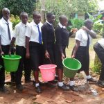 The Water Project: Lwanda Secondary School -  Getting Water For Cleaning The Classroom