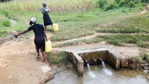 The Water Project:  Support Staff Fetching Water