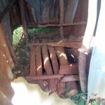 The Water Project: Mukangu Community, Lihungu Spring -  Dangerous Wooden Latrine Floor