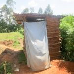 The Water Project: Shihingo Community, Mangweli Spring -  Sample Latrine