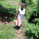 The Water Project: Mukoko Community, Mukoko Spring -  Carrying Water Home