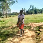 The Water Project: Sabane Primary School -  Carrying Bricks To The Artisans