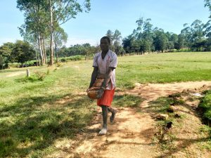 The Water Project:  Carrying Bricks To The Artisans