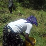The Water Project: Mwichina Community, Matanyi Spring -  Carrying Water