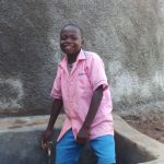 The Water Project: Lukala Primary School -  Student At The Tank To Gather Water