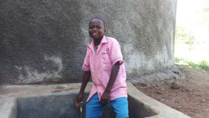 The Water Project:  Student At The Tank To Gather Water