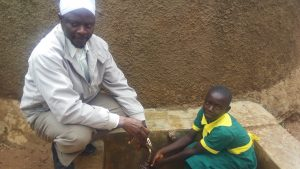 The Water Project:  Headteacher Gilbert Lichina And Rebeccah Migare Gathering Water At The Tank