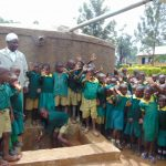 The Water Project: Buhunyilu Primary School -  Students Gathered At The Tank