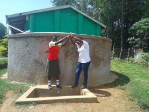 The Water Project:  Fidelia Ajwang And Field Officer Jacklyne Chelagat