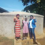 The Water Project: Irenji Primary School -  Posing In Front Of The Tank A Year After It Was Built