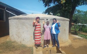 The Water Project:  Posing In Front Of The Tank A Year After It Was Built