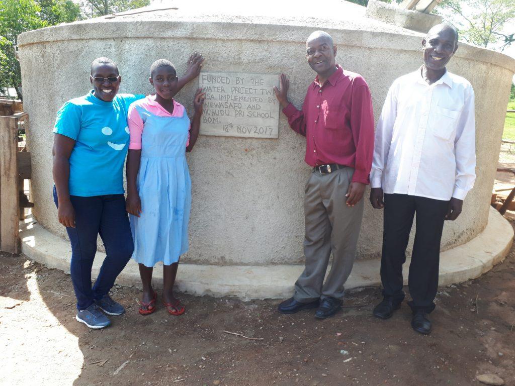 The Water Project : kenya4688-field-officer-janet-kayi-wilikister-kageha-deputy-headteacher-david-ivayo-imbayia-and-solomon-msolo