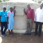 The Water Project: Muhudu Primary School -  Field Officer Janet Kayi Wilikister Kageha Deputy Headteacher David Ivayo Imbayia And Solomon Msolo