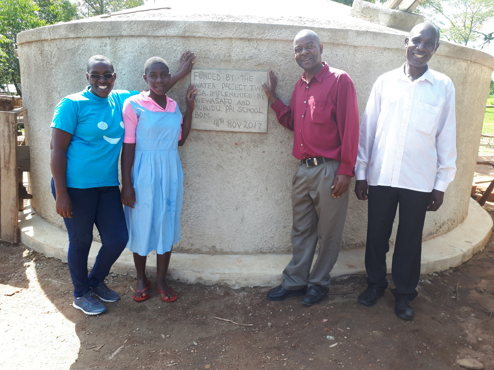 The Water Project : kenya4688-field-officer-janet-kayi-wilikister-kageha-deputy-headteacher-david-ivayo-imbayia-and-solomon-msolo