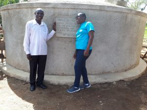 The Water Project:  Solomon Msolo Board Chair At Muhudu Primary With Janet At The Tank