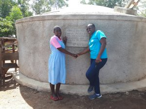 The Water Project:  Wilikister Kageha With Field Officer Janet Kayi At The Water Tank