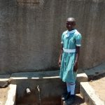 The Water Project: Shibale Primary School -  A Students At The Tank To Collect Water