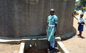 The Water Project:  A Students At The Tank To Collect Water