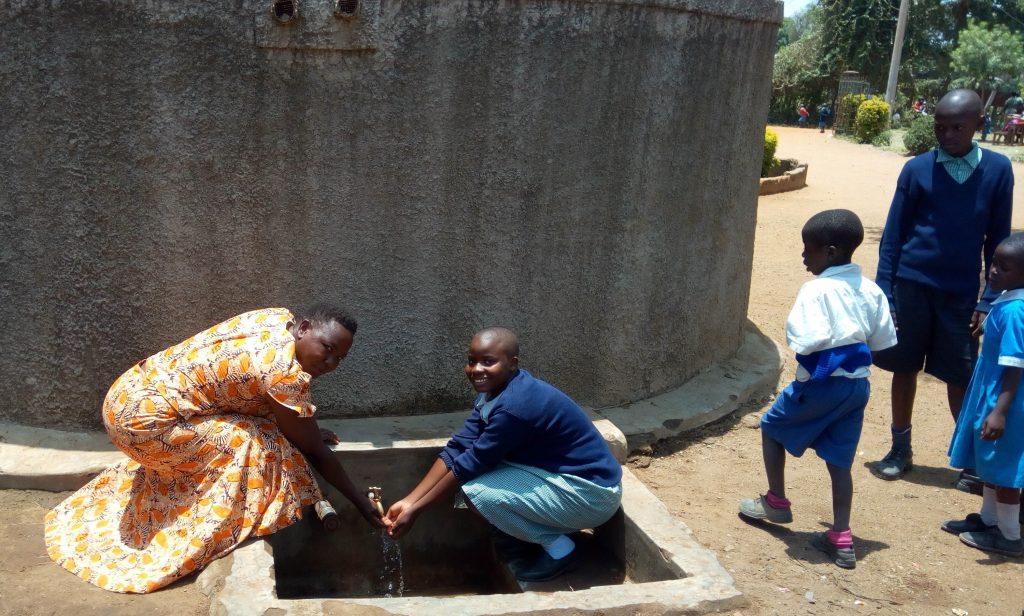 The Water Project : kenya4689-field-officer-betty-majani-and-precious-adhiambo