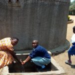 The Water Project: Shibale Primary School -  Field Officer Betty Majani And Precious Adhiambo